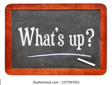 What's up? Informal, casual or urban slang greeting - white chalk text on a vintage slate blackboard