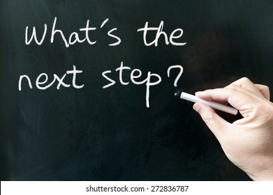 What's the next step words written on the blackboard using chalk