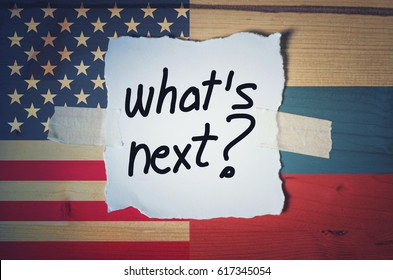 What's Next? on torn paper with Russian and American flag