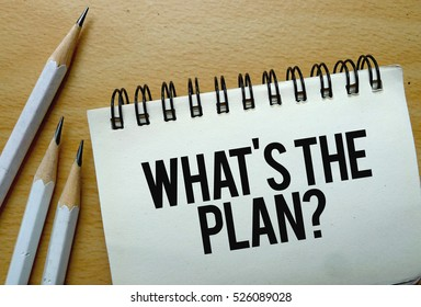 Whats the Plan text written on a notebook with pencils