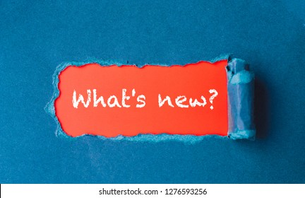 """What's new?"" Torn Paper Revealing Question Mark"