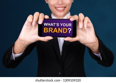 What's Your Brand?, Happy businesswoman Show text What's Your Brand? on smart phone.