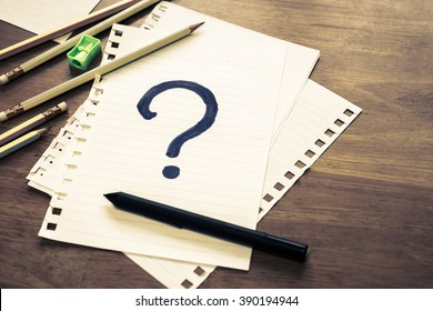 What's Your Story, Question Mark on papers with many pencils
