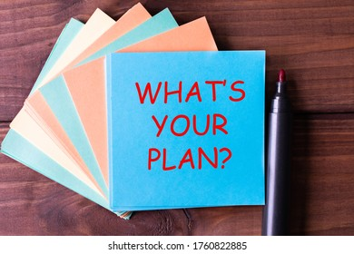 What's your plan? - tex on blue sticker on wooden backround. Business concept.