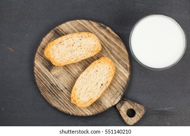 Wheat bread on a wooden background. Bio products. Food.