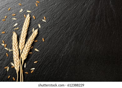 wheat ears on black stone texture