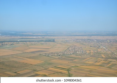 Wheat fields, plains with different plants and a city suburb seen from a landing plane