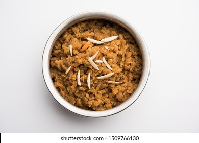 Wheat flour Halwa or Shira /  Atte ka Halva, Popular healthy dessert or breakfast menu from India. served in a bowl or plate. selective focus