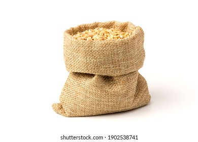 wheat grain in a baggy bag, isolated on a white background. the concept of harvest