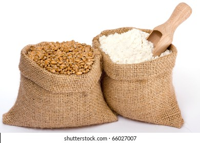 Wheat grain and flour in small burlap sacks