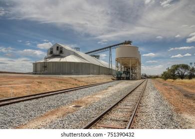 A wheat grain storage facility next tot he railway in rural Australia