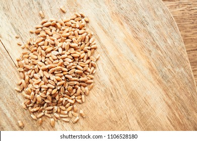 wheat grains on a wooden background