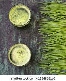 Wheat grass and glass of green juice- overhead shot
