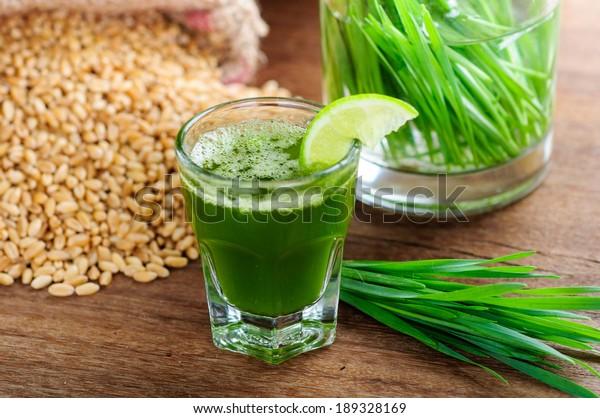 wheat grass juice on table