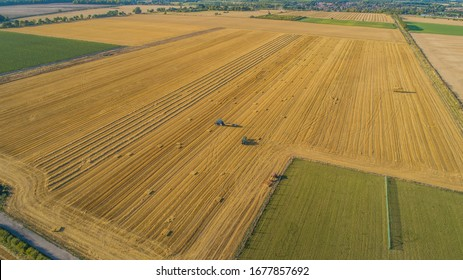 Wheat harvest drone shots with combine and tractor.