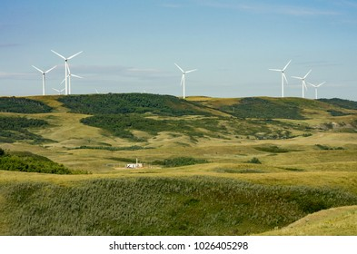Wheatland County, Alberta, Canada.  Renewable wind and non-renewable gas energy production in the Wintering Hills south of Drumheller in the summer.