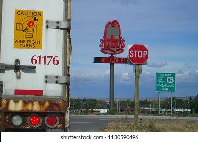 WHEATLAND, WYOMING - OCTOBER 1: Fast food signs and turning truck on Interstate Highway 25 on October 1, 2009 in Wheatland, Wyoming. Wheatland is the county seat of Platte County in southeastern Wyomi