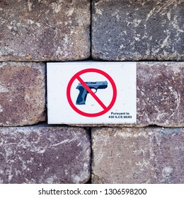 Wheaton, Chicago, Illinois. USA. September 11, 2018. 'No guns allowed' sign at the entrance to a local park.