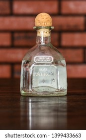Wheaton, Illinois/ United States - May 13th, 2019: Patron is a brand of tequila products by the Patron Spirits Company. This bottle is Patron Silver on a brick background. - Image
