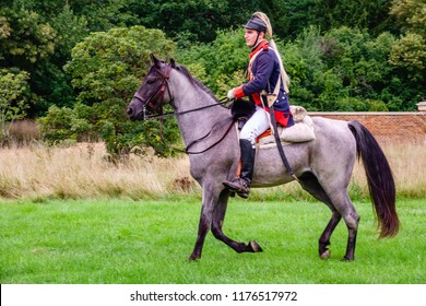 WHEATON, ILLINOIS/USA - SEPT. 8, 2018: A cavalryman in period uniform demonstrates equestrian technique during a weekend reenactment of the American Revolutionary War (1775-1783) at Cantigny Park.