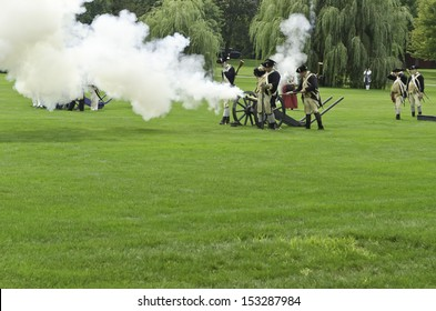 WHEATON, ILLINOIS/USA - SEPTEMBER 7: American Revolutionary War (1775-1783) reenactment on September 7, 2013, in Wheaton, IL. Actors dressed as soldiers of the Continental Army fire a cannon.