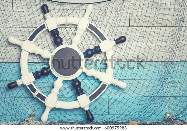 Wheel against the background of blue-white boards