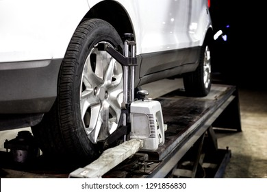 Wheel aligment service on garage with robot technology in automotive car repairing