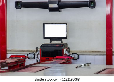 Wheel alignment equipment in a car repair station, Car Steering Wheel Balancer Calibrate with laser reflector attach on each tire to center driving adjust. Car concept