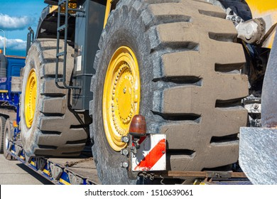 wheel of a bulldozer close-up on a transport platform. Concept: road construction, heavy construction equipment.