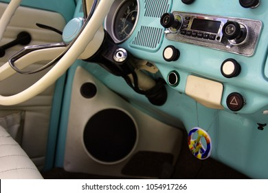 wheel car of mid-20th century. Interior, interior of old car (car salon) with radio and control keys. Soviet government car GAZ-13 Chaika, Executive passenger vehicle