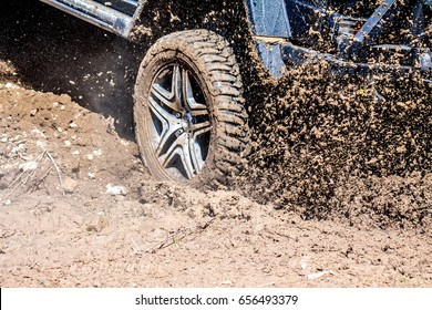 Wheel of the car in the mud
