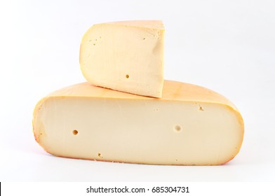 Wheel cheese cut in half on white background.