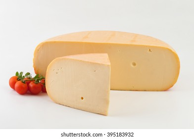 Wheel cheese cut in half in white background.