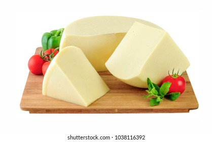 Wheel of cheese and two large pieces on wooden board. Clipping path.