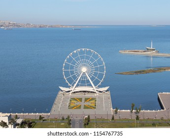 Wheel of fortune in Baku boulevard in summer