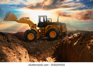 Wheel loader are digging the soil in the construction site on the  sunlight background