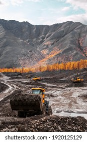 Wheel loader during excavation in the mountains of Eastern Siberia