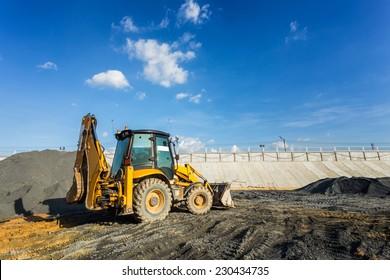 Wheel loader excavator machine working in construction site