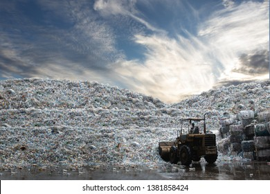 wheel loader working load bottle plastic recycle from the mountain of plastic bottle