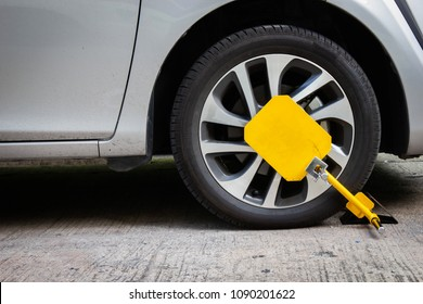 Wheel lock for anti-theft with the car on the road or concrete floor.