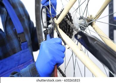 Wheel manufacturing. The service provider repairs the bike in the bike service.