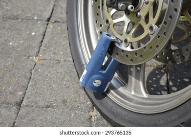 Wheel of a motorbike locked with a padlock