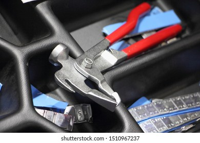 Wheel pliers and self-adhesive balancing weights, new equipment for car tyre service balance tools close up