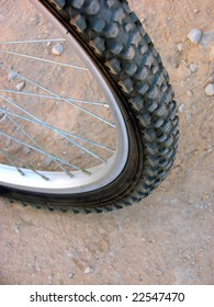 wheel and the rubber tyre of a road bicycle