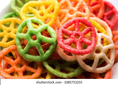 wheel shape colourful Fryums Papad is a crunchy Snack Pellets served in a bowl