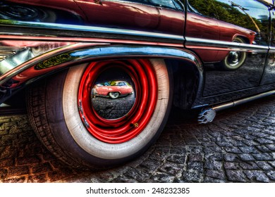 Wheel and side from a Ford Galaxie V8 1961, great american vintage car