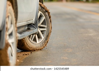 Wheel of SUV car with dirty from mud and clay. Parking on the road for safe drive concept