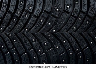 Wheel tire seamless pattern. A close up of a tire protector and studs. Winter tyre texture. Realistic illustration. Black rubber, studs and protector background.