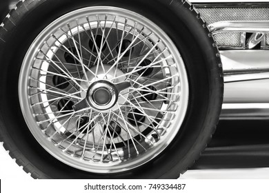 Wheel with tire of vintage race car close up.Black and white color