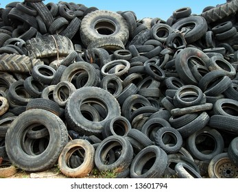 A lot of Wheel Tires dumped in a landfill